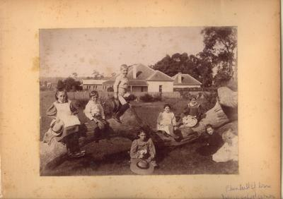 Plunkett St Nowra Infants School - Group of 8 children posed on fallen tree