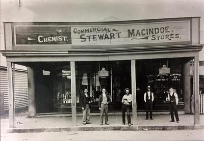 Five Men Outside Stewart Macindoe Stores